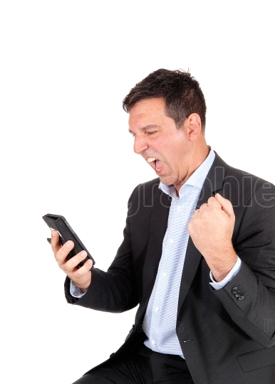 Business man screaming at his cellphone