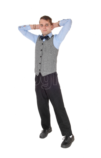 Business man standing with his hands behind his head