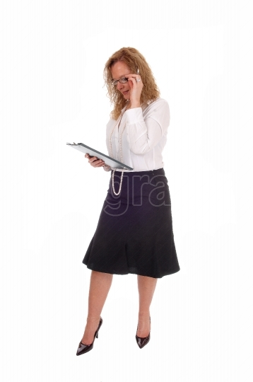 Business woman looking at her clipboard.