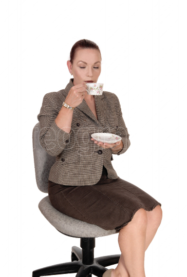 Business woman sitting with a cup of coffee