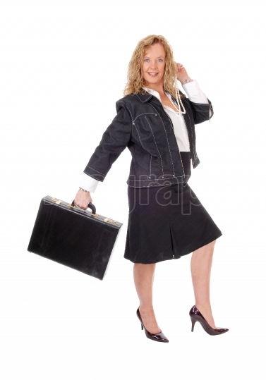 Business woman walking with briefcase.