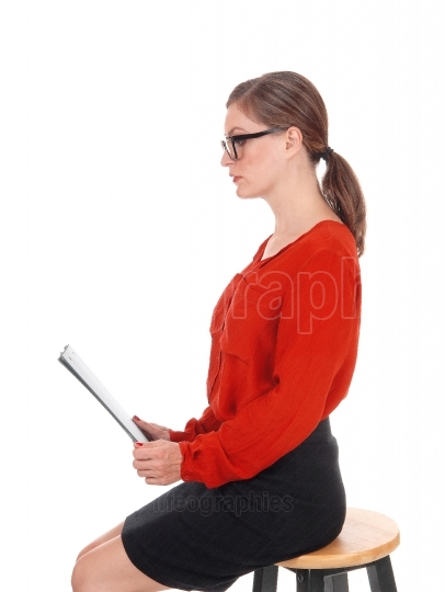 Business woman with glasses and folder