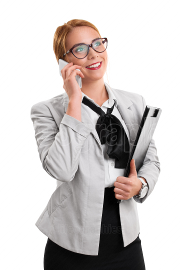 Businesswoman talking on the phone holding a notepad