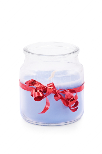 Candle wrapped in red ribbon