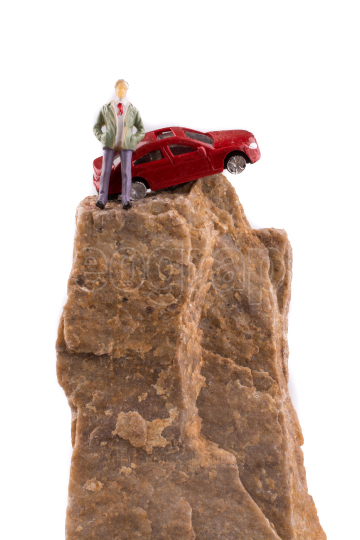 Car near a figure on rock