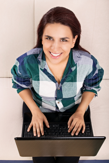 Casual girl working on a computer