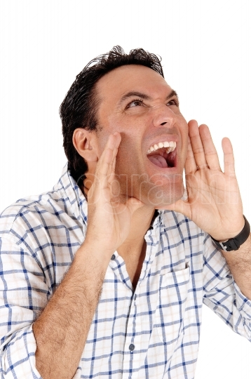 Caucasian man shouting with hands on mouth