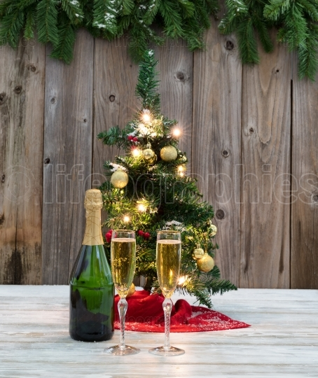 Champagne for the winter holidays with Christmas tree decoration