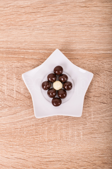 Chocolate balls on a star shaped saucer