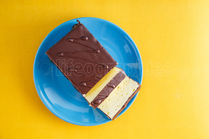 Chocolate cake on colored background
