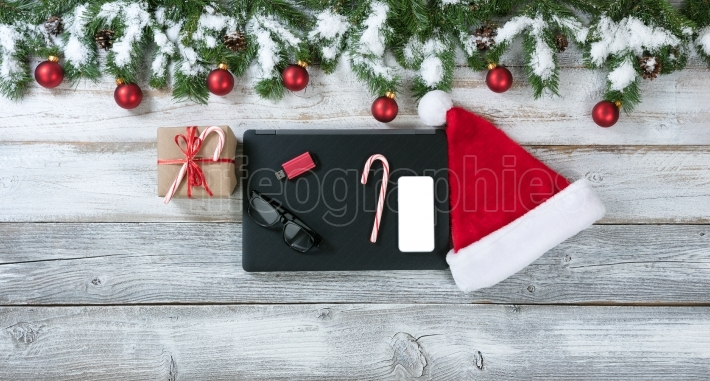 Christmas and technology items at work background