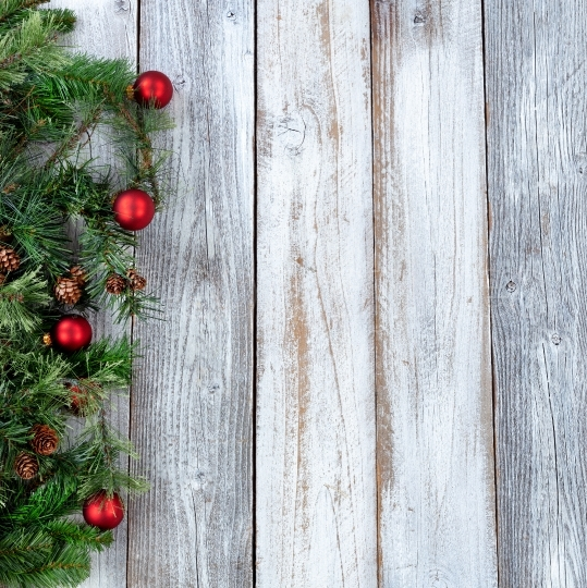 Christmas background with evergreen branches and red ornaments o