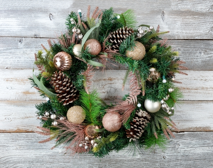 Christmas holiday wreath with illuminated lights on rustic white