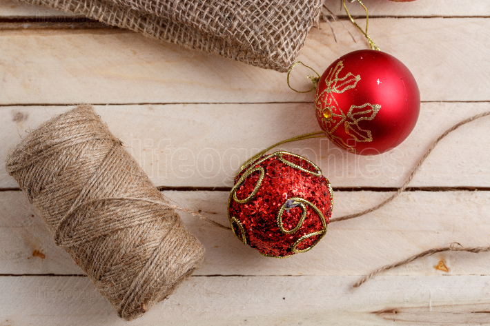 Christmas toys on a light wooden background with a canvas and a