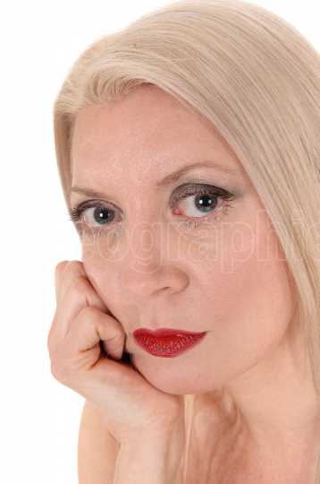 Close up head shoot of a beautiful blond woman looking in camera