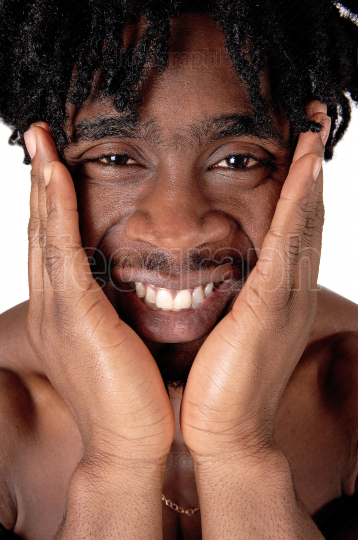 Close up image of a black man with his hands on the face