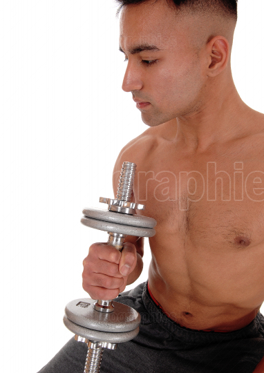 Close up image of a man with dumbbells