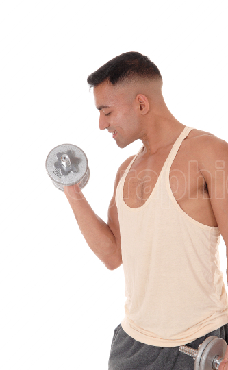 Close up image of a man with two dumbbells