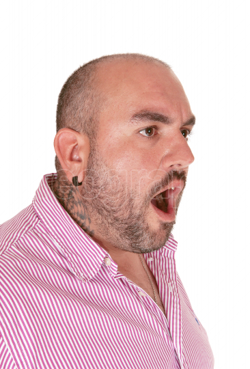 Close up image of a shouting Hispanic man