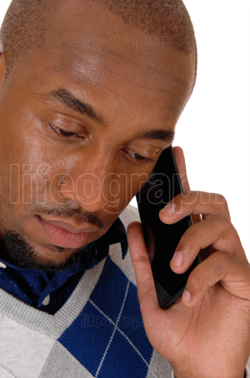 Close up image of an African man on his cellphone