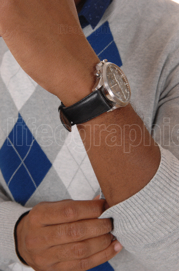 Close up image of the arm and wristwatch on a man