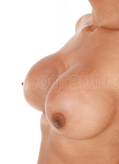Close up image of the big breasts of a young woman