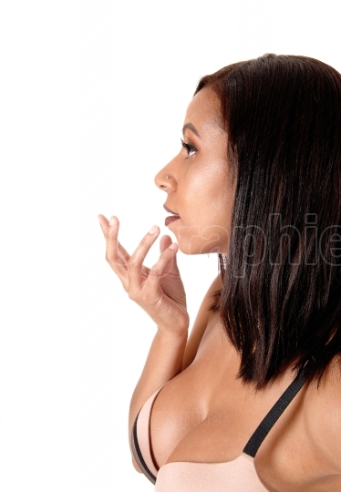 Close up image of woman in bra hand on face