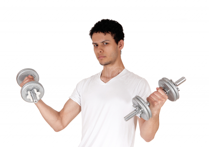 Close up of a young man exercising with two dumbbells