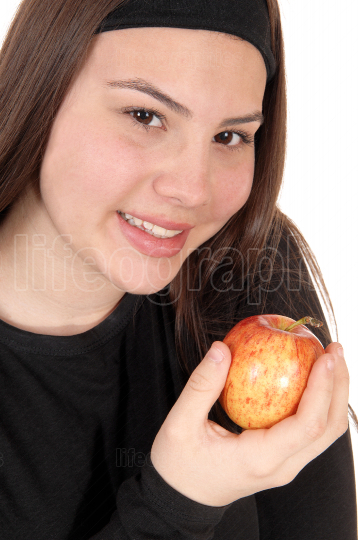 Close up of girl holding a red apple and smiling