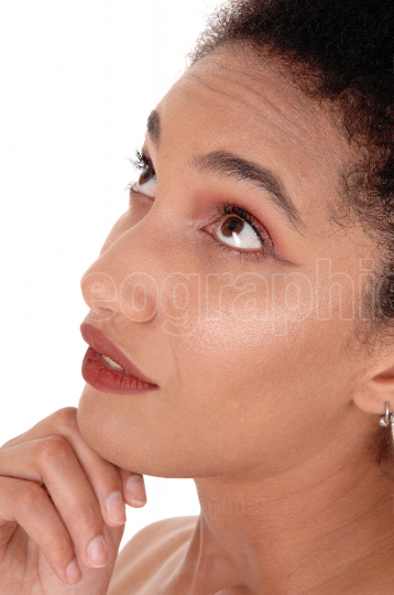 Close up of the face of a multi racial woman looking up