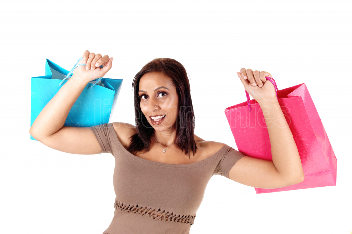 Close up of woman in dress holding her shopping bags up