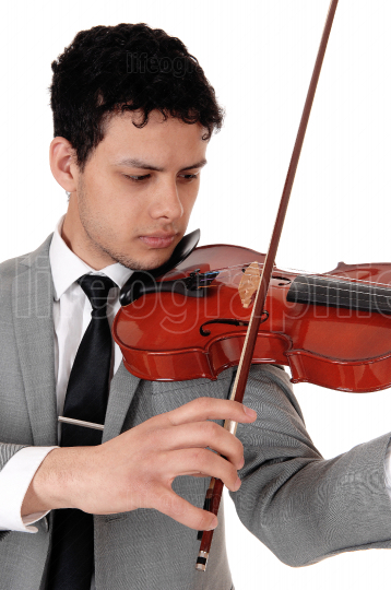 Close up of young man playing the violin