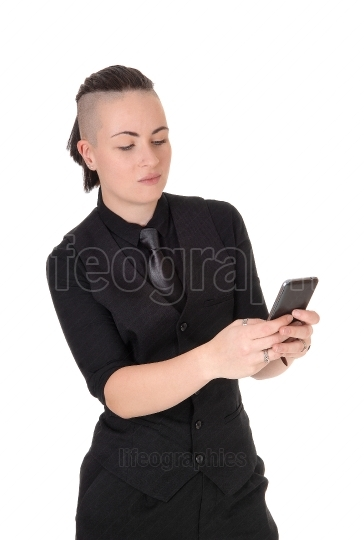 Close up of young woman texting on her phone