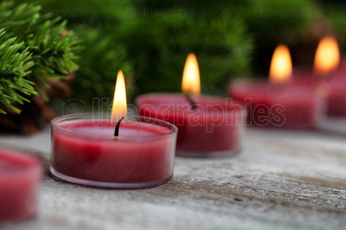 Close up view of traditional glowing Christmas holiday candles w