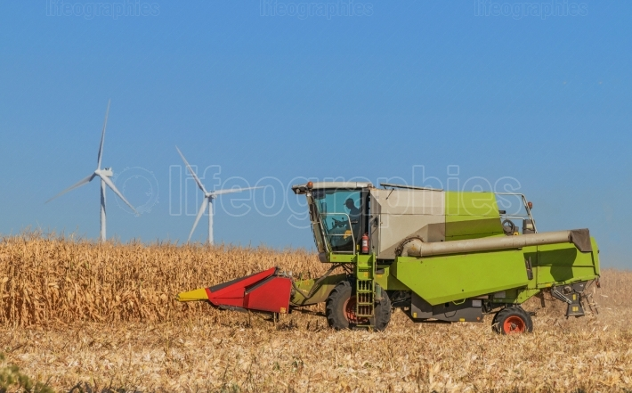 Close-up of a combine harvesting in Romania