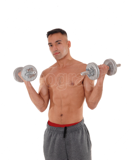 Closeup of a man with two dumbbells