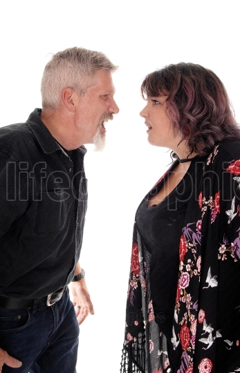 Closeup of fighting middle age couple
