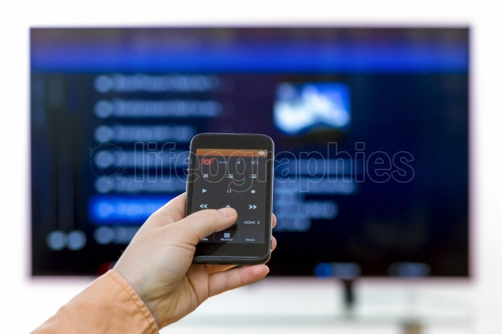 Closeup on woman hand holding smartphone and use app remote