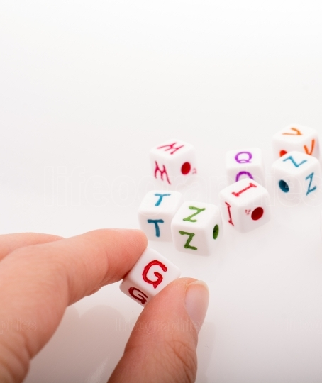 Colorful alphabet letter cubes in hand