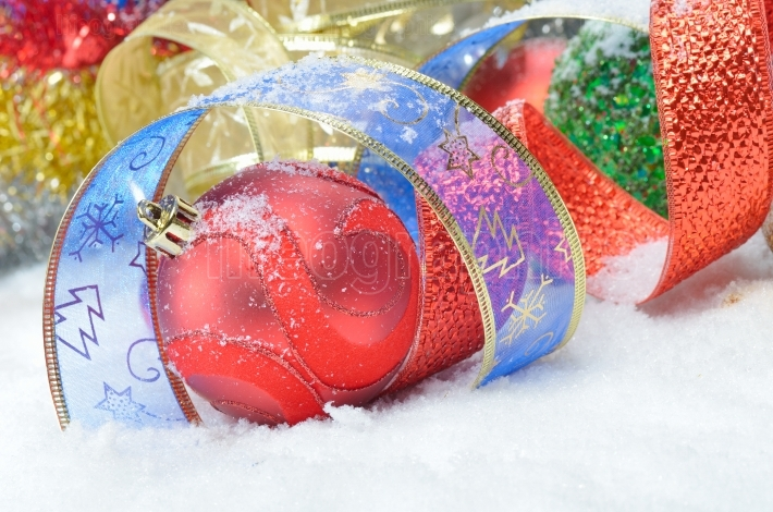 Colorful christmas decorations over snow