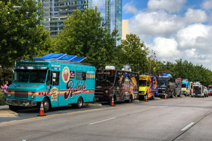 Colorful Food Trucks Parked In A Row On Dallas Street