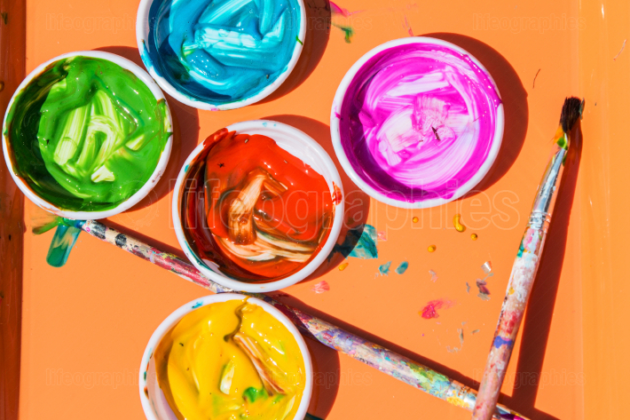 Colorful Paints Sit In Containers For Kids To Paint With