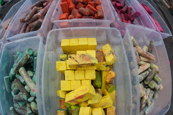 Colorful Pieces Of Chalk Sit In Plastic Containers