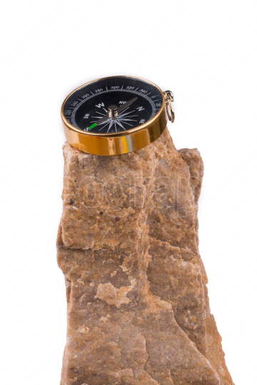 Compass on rock