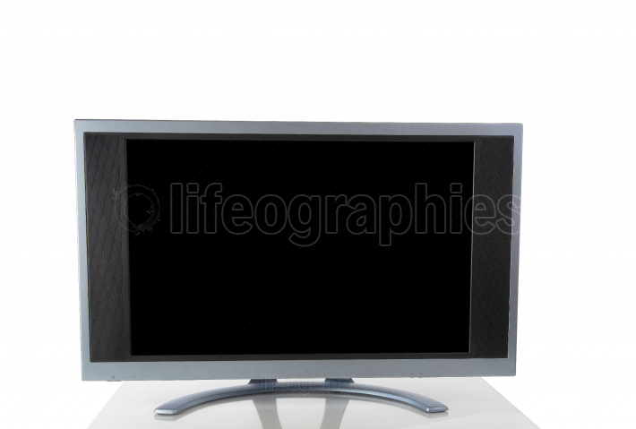 Computer screen monitor isolated on white background with reflec