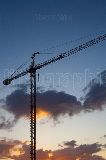 Construction site with crane at sunset