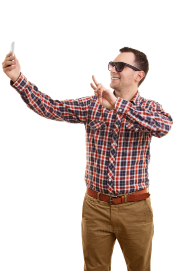 Cool young man taking a selfie