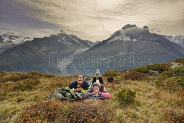 Couple hikers relaxing near a lake.