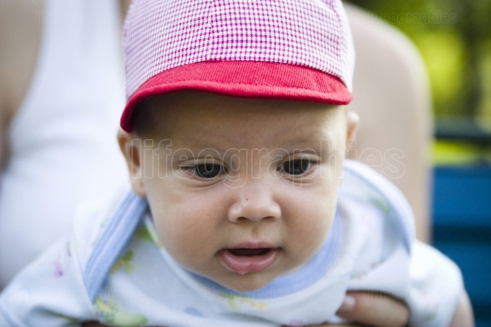 Cute baby wearing cap