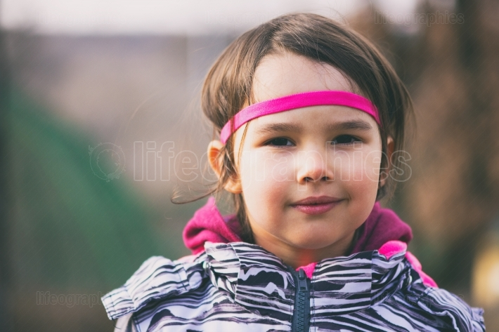 Cute little girl outdoor wearing a headband